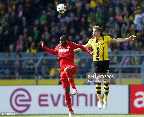 Matthias Ginter of Borussia Dortmund challenges with Anthony Modeste of 1FC Cologne during the Bundesliga match between Borussia Dortmund and FC...