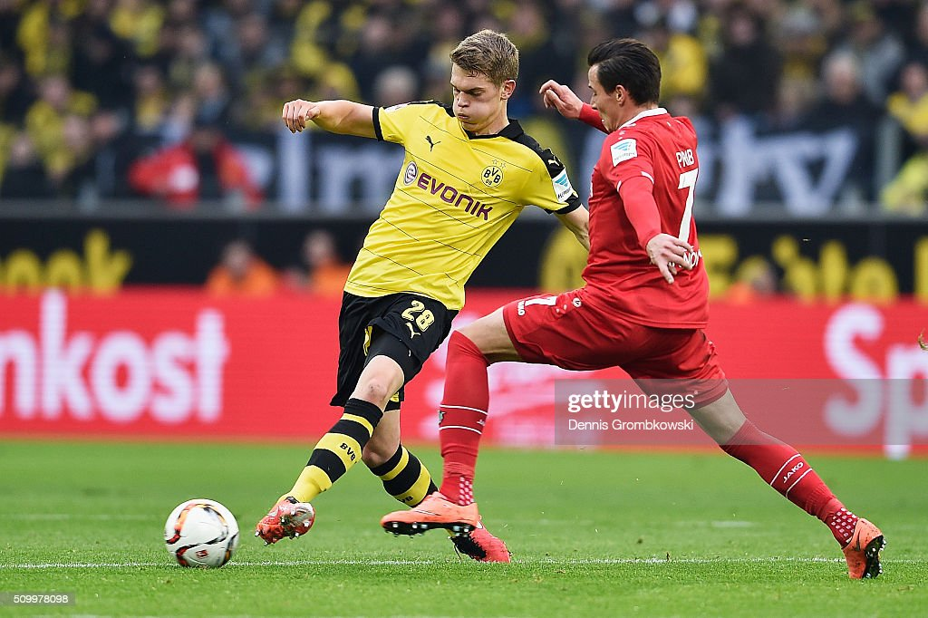 <a gi-track='captionPersonalityLinkClicked' href=/galleries/search?phrase=Matthias+Ginter&family=editorial&specificpeople=8616925 ng-click='$event.stopPropagation()'>Matthias Ginter</a> of Borussia Dortmund controls the ball under the pressure of Edgar Prib of Hannover 96 during the Bundesliga match between Borussia Dortmund and Hannover 96 at Signal Iduna Park on February 13, 2016 in Dortmund, Germany.