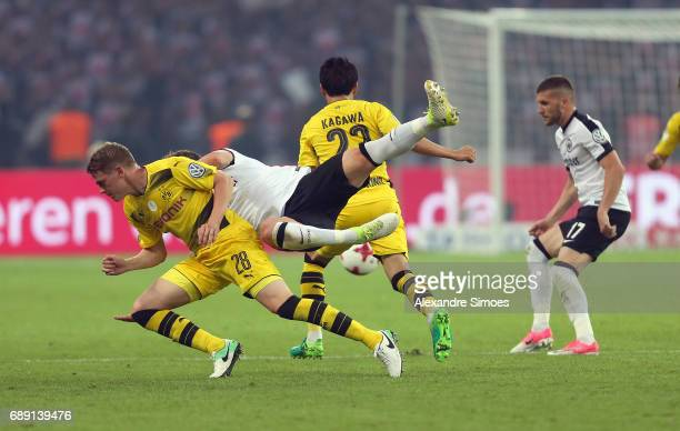 Matthias Ginter of Borussia Dortmund gets challenged by Bastian Oczipka of Eintracht Frankfurt during the DFB Cup Final match between Eintracht...