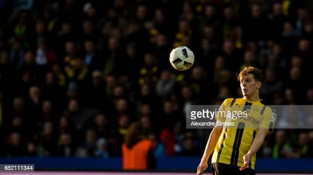 Matthias Ginter of Borussia Dortmund in action during the Bundesliga match between Hertha BSC and Borussia Dortmund at the Olympiastadion on March 11...