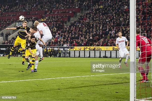 Matthias Ginter of Borussia Dortmund Marc Bartra of Borussia Dortmund Dominique Heintz of 1FC Koln Frederik Sorensen of 1FC Koln Salih Ozcan of 1FC...