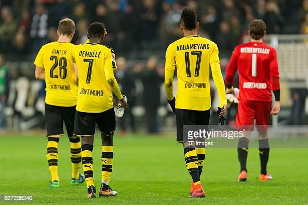Matthias Ginter of Borussia Dortmund Ousmane Dembele of Borussia Dortmund PierreEmerick Aubameyang of Borussia Dortmund and goalkeeper Roman...