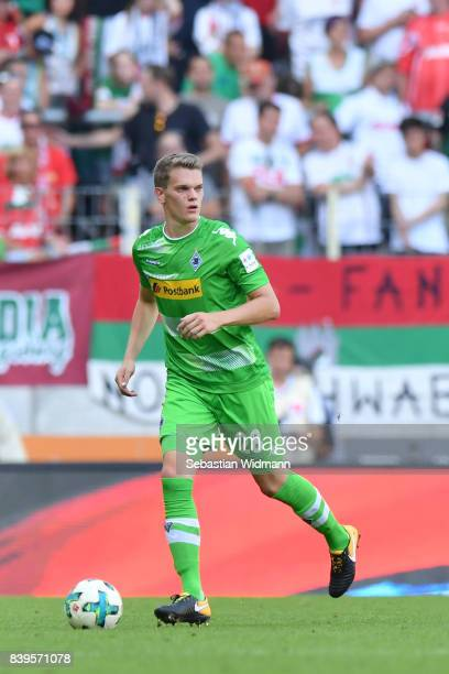 Matthias Ginter of Borussia Moenchengladbach plays the ball during the Bundesliga match between FC Augsburg and Borussia Moenchengladbach at WWKArena...