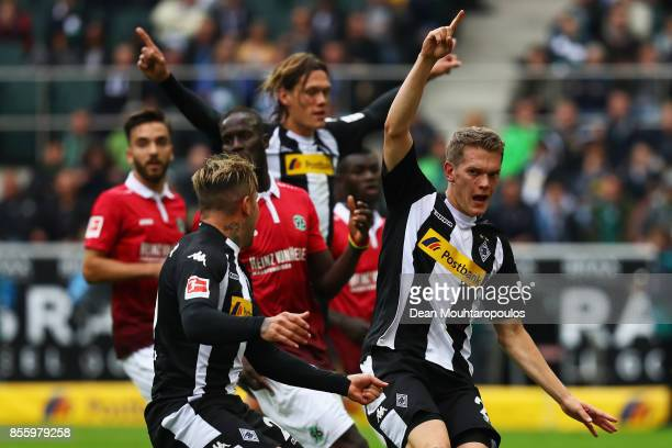 Matthias Ginter of Borussia Monchengladbach celebrates scoring his teams first goal of the game during the Bundesliga match between Borussia...