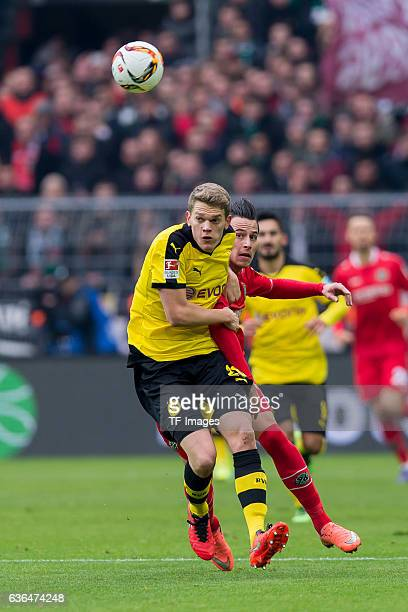 Matthias GINTER of Bosussia Dortmund and Edgar PRIB of Hannover 96 battle for the ball during the Bundesliga match between Borussia Dortmund and...
