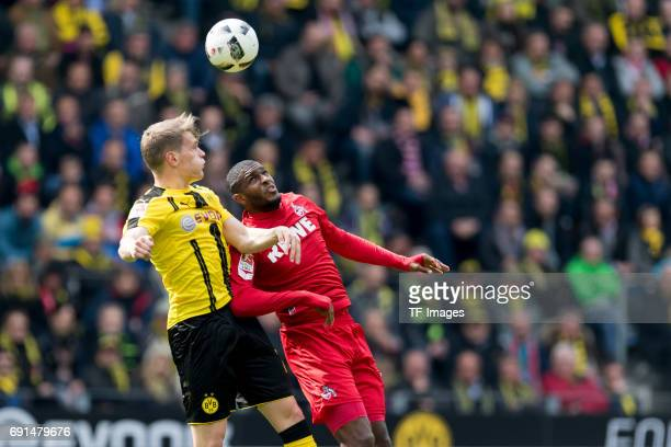 Matthias Ginter of Dortmund and Anthony Modeste of Colonge battle for the ball during the Bundesliga match between Borussia Dortmund and FC Koeln at...