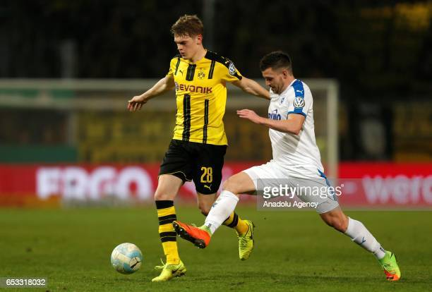 Matthias Ginter of Dortmund and Bernd Rosinger of Lotte in action during the DFB Cup quarter final between Sportfreunde Lotte and Borussia Dortmund...