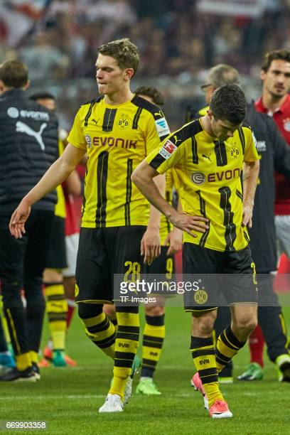 Matthias Ginter of Dortmund and Christian Pulisic of Dortmund looks dejected during the Bundesliga match between Bayern Muenchen and Borussia...