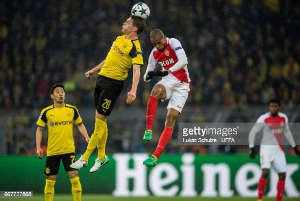 Matthias Ginter of Dortmund and Fabinho of Monaco in action during the UEFA Champions League Quarter Final first leg match between Borussia Dortmund...