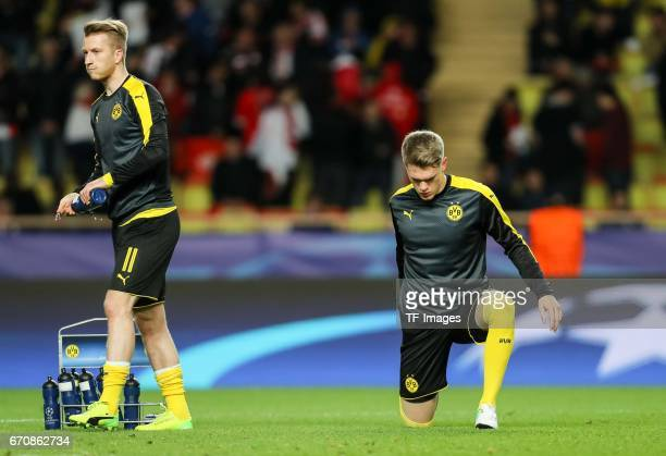 Matthias Ginter of Dortmund and Marco Reus of Dortmund looks on during the UEFA Champions League quarter final second leg match between AS Monaco and...