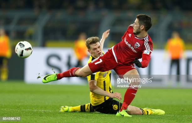 DORTMUND GERMANY MARCH 17 Matthias Ginter of Dortmund and Mathew Leckie of Ingolstadt challenge for a ball during the Bundesliga soccer match between...