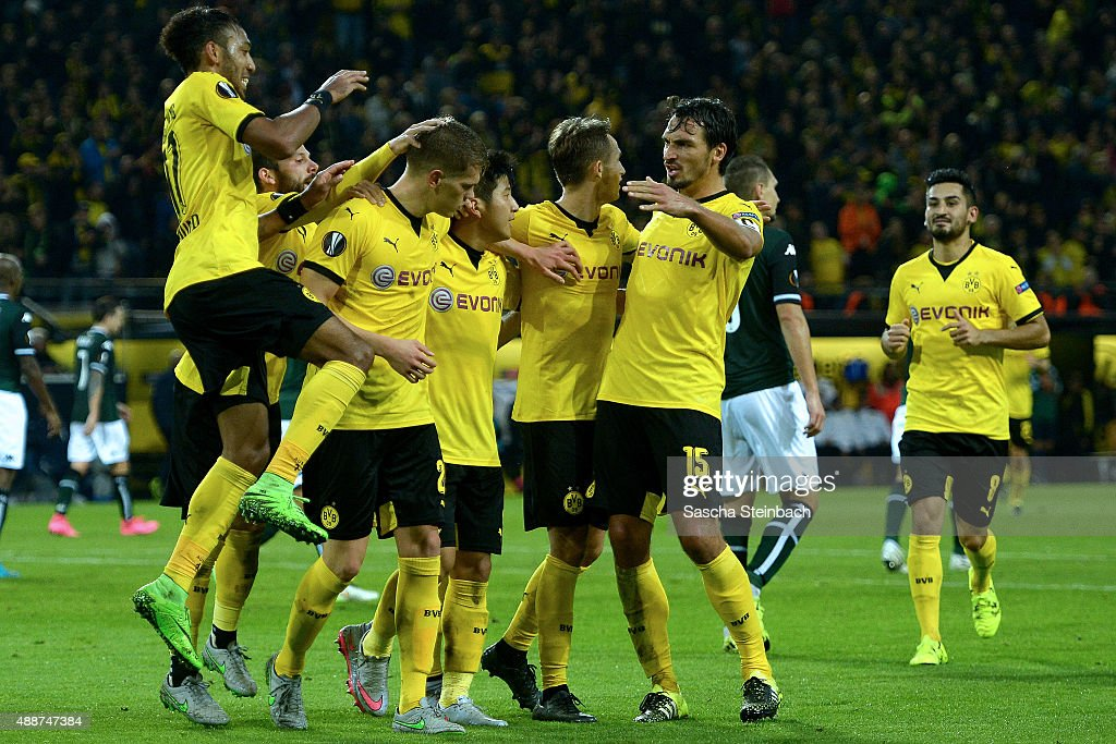 Matthias Ginter of Dortmund celebrates with team mates after scoring his team's first goal during the UEFA Europa League Group C match between...