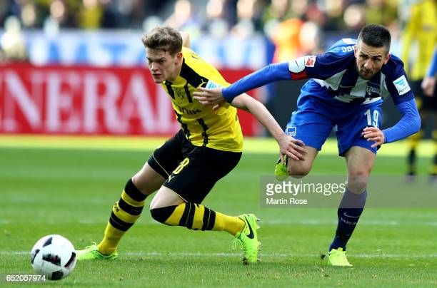 Matthias Ginter of Dortmund challenges Vedad Ibisevic of Berlin during the Bundesliga match between Hertha BSC and Borussia Dortmund at...
