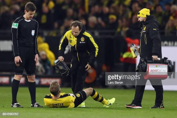 Matthias Ginter of Dortmund receives treatment during the Bundesliga match between Borussia Dortmund and FC Ingolstadt 04 at Signal Iduna Park on...