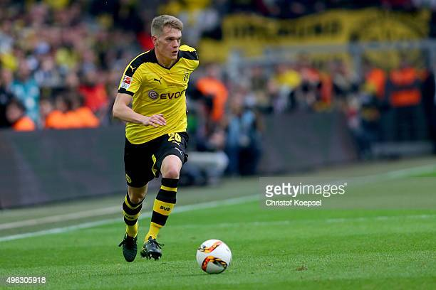 Matthias Ginter of Dortmund runs with the ball during the Bundesliga match between Borussia Dortmund and FC Schalke 04 at Signal Iduna Park on...