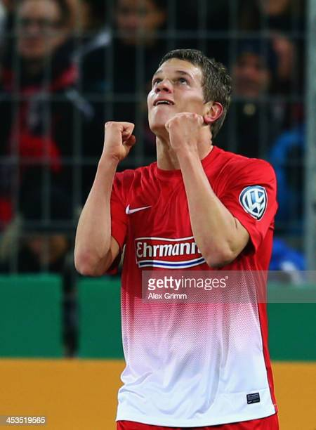 Matthias Ginter of Freiburg celebrates his team's first goal during the German Cup Round of 16 match between SC Freiburg and Bayer Leverkusen at MAGE...