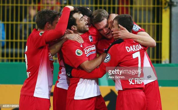Matthias Ginter of Freiburg celebrates his team's first goal with team mates during the German Cup Round of 16 match between SC Freiburg and Bayer...