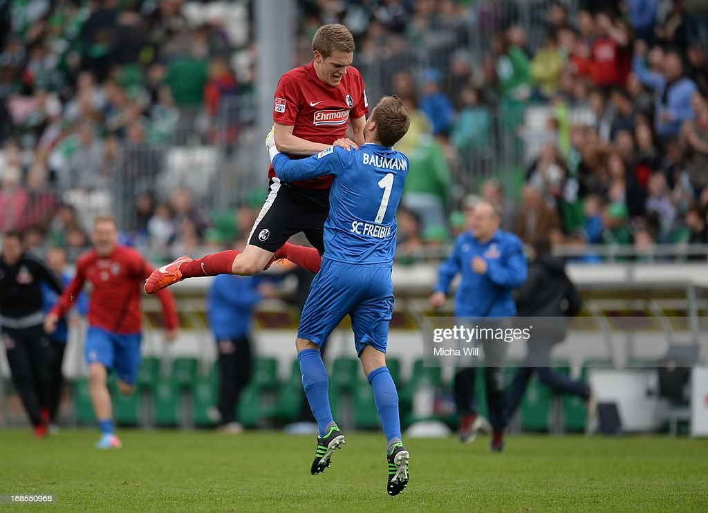 Matthias Ginter of Freiburg celebrates with goalkeeper Oliver Baumann the win of their team after the Bundesliga match between SpVgg Greuther Fuerth and SC Freiburg at Trolli-Arena on May 11, 2013 in Fuerth, Germany.