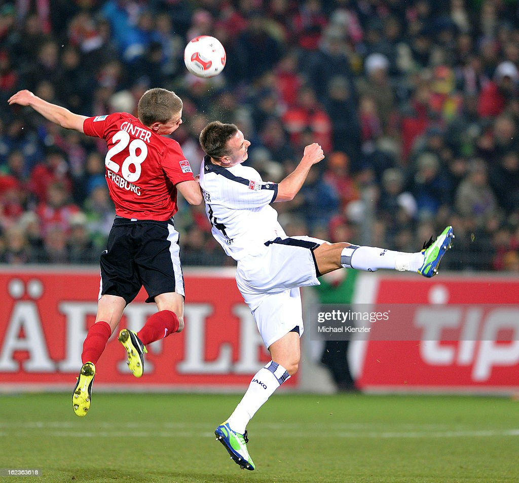 <a gi-track='captionPersonalityLinkClicked' href=/galleries/search?phrase=Matthias+Ginter&family=editorial&specificpeople=8616925 ng-click='$event.stopPropagation()'>Matthias Ginter</a> (l) of Freiburg challenges <a gi-track='captionPersonalityLinkClicked' href=/galleries/search?phrase=Alexander+Meier&family=editorial&specificpeople=615512 ng-click='$event.stopPropagation()'>Alexander Meier</a> during the Bundesliga match between SC Freiburg and Eintracht Frankfurt at MAGE SOLAR Stadium on February 22, 2013 in Freiburg, Germany.