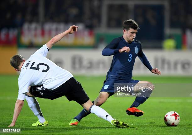 Matthias Ginter of Germany challenges Ben Chilwell of England during the U21 international friendly match between Germany and England at BRITAArena...