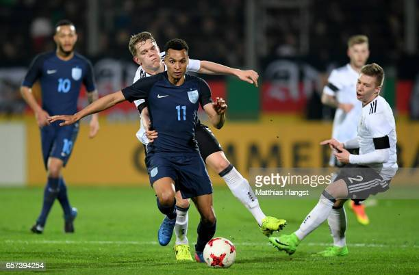 Matthias Ginter of Germany challenges Jacob Murphy of England during the U21 international friendly match between Germany and England at BRITAArena...