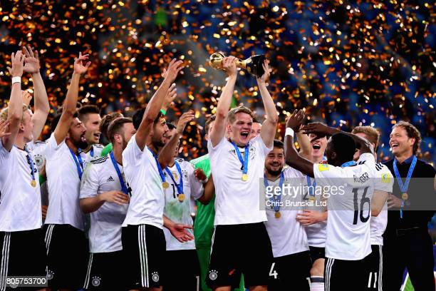 Matthias Ginter of Germany lifts the FIFA Confederations Cup trophy after the FIFA Confederations Cup Russia 2017 Final match between Chile and...