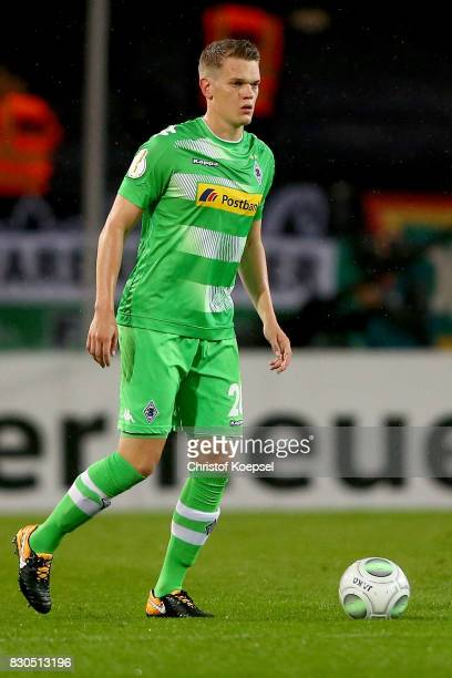 Matthias Ginter of Mnchengladbach runs with the ball during the DFB Cup first round match between RotWeiss Essen and Borussia Moenchengladbach at...