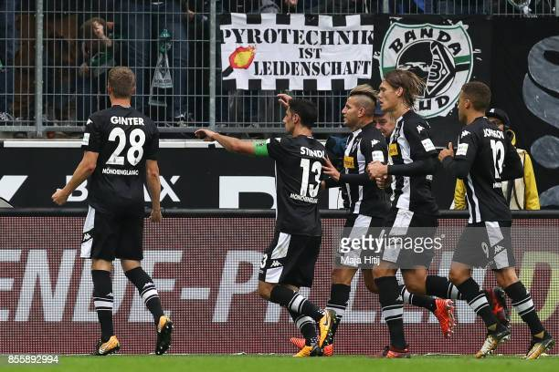 Matthias Ginter of Moenchengladbach celebrates after scoring his team's first goal to make it 10 during the Bundesliga match between Borussia...