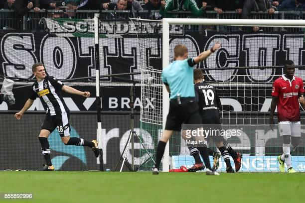 Matthias Ginter of Moenchengladbach celebrates after scoring his team's first goal to make it 10 during the Bundesliga match between Borussia...