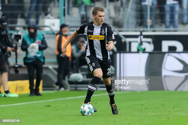 Matthias Ginter of Moenchengladbach controls the ball during the Bundesliga match between Borussia Moenchengladbach and Hannover 96 at BorussiaPark...