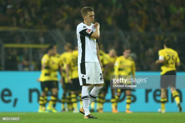 Matthias Ginter of Moenchengladbach looks dejected after Dortmund scored their sixth goal during the Bundesliga match between Borussia Dortmund and...