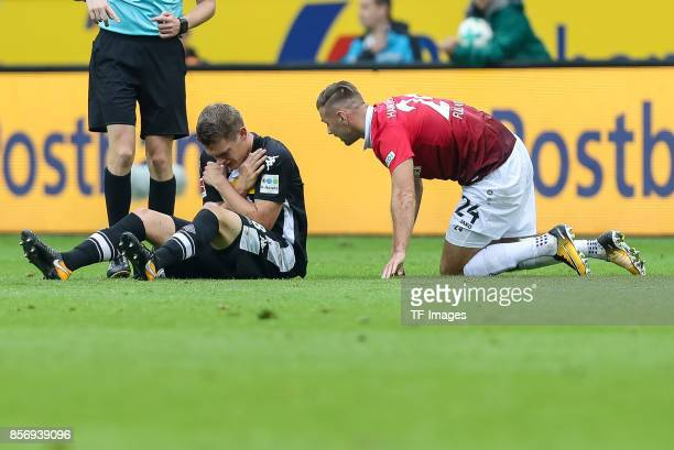 Matthias Ginter of Moenchengladbach Niclas Fuellkrug of Hannover on the groundduring the Bundesliga match between Borussia Moenchengladbach and...