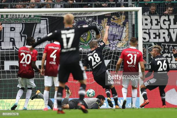Matthias Ginter of Moenchengladbach scores his team's first goal to make it 10 during the Bundesliga match between Borussia Moenchengladbach and...