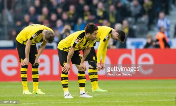 Matthias Ginter Shinji Kagawa and Julian Weigl of Borussia Dortmund after the final whistle during the Bundesliga match between Hertha BSC and...