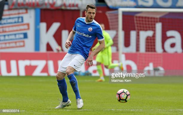 Matthias Henn of Rostock runs with the ball during the third league match between FC Hansa Rostock and 1FC Magdeburg at Ostseestadion on April 15...