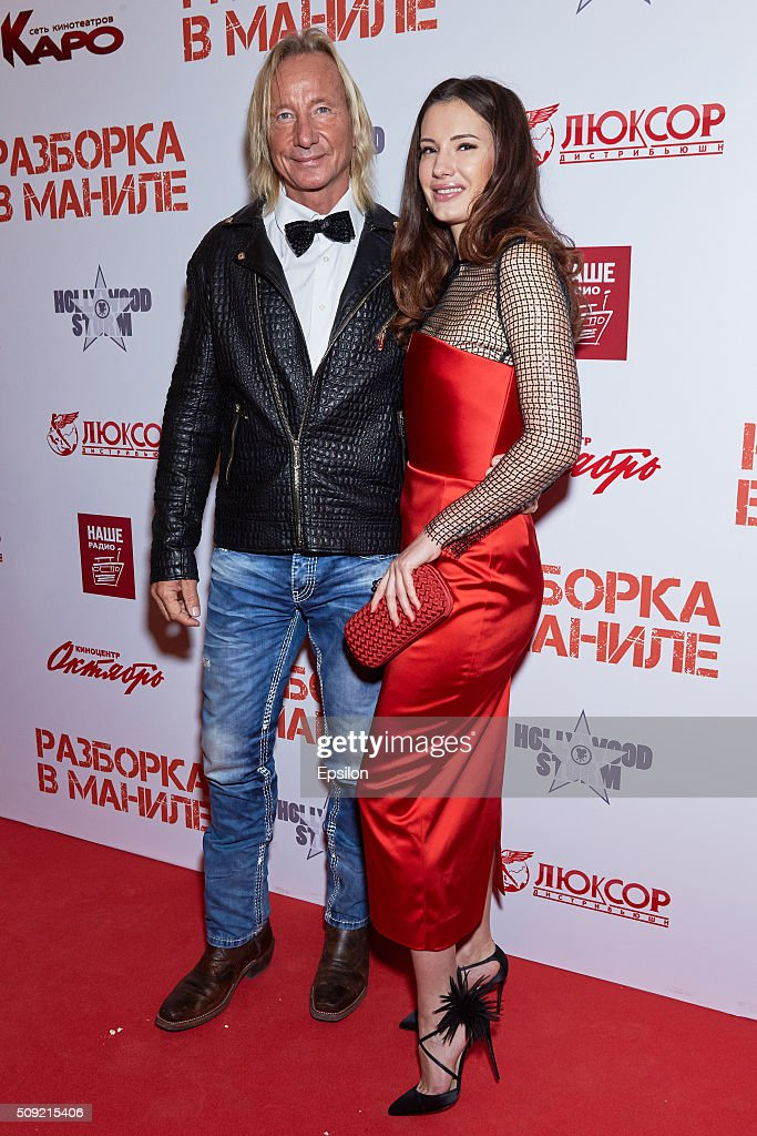 Matthias Hues and Natalya Gubina attend 'Showdown in Manila' premiere in October cinema hall on February 9, 2016 in Moscow, Russia.