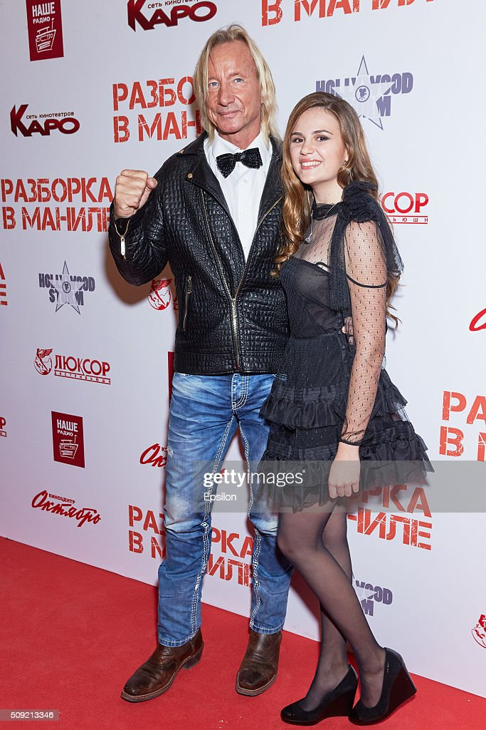 Matthias Hues and Polina Butorina attend 'Showdown in Manila' premiere in October cinema hall on February 9, 2016 in Moscow, Russia.