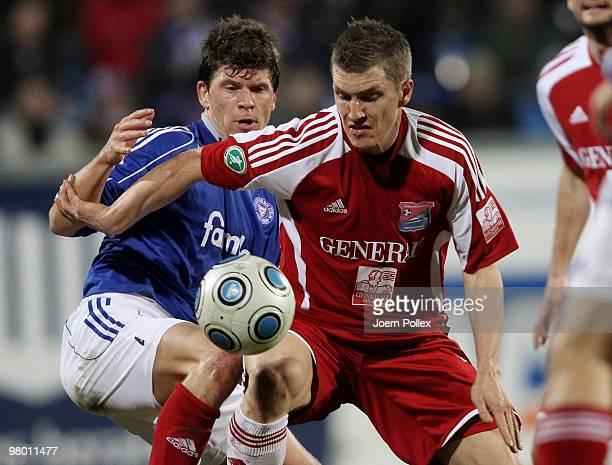 Matthias Hummels of Kiel and Tobias Schweinsteiger of Unterhaching compete for the ball during the 3 Liga match between Holstein Kiel v SpVgg...