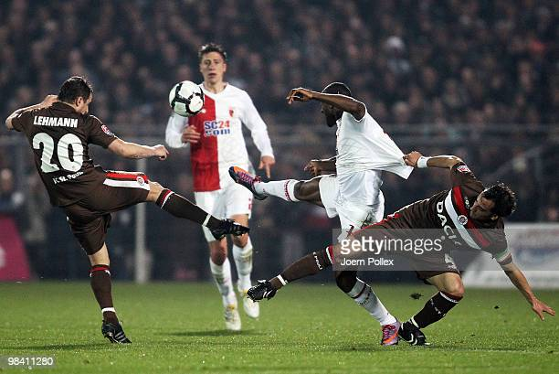Matthias Lehmann and Fabio Morena of St Pauli and Nando Rafael of Augsburg compete for the ball during the Second Bundesliga match between FC St...