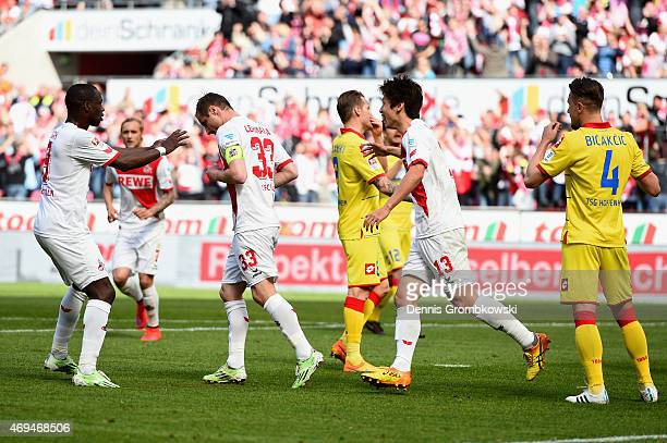 Matthias Lehmann of 1 FC Koeln celebrates as he scores the opening goal from a penalty during the Bundesliga match between 1 FC Koeln and 1899...