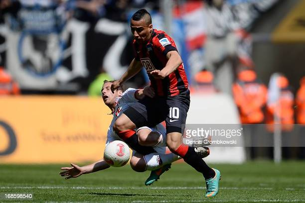 Matthias Lehmann of 1 FC Koeln is challenged by Anis BenHatira of Hertha BSC Berlin during the Second Bundesliga match between 1 FC Koeln and Hertha...