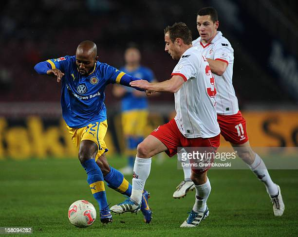 Matthias Lehmann of Cologne and Dominik Kumbela of Braunschweig battle for the ball during the Bundesliga match between 1 FC Koeln and Eintracht...