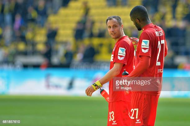 Matthias Lehmann of Colonge and Anthony Modeste of Colonge looks on during the Bundesliga match between Borussia Dortmund and FC Koeln at Signal...