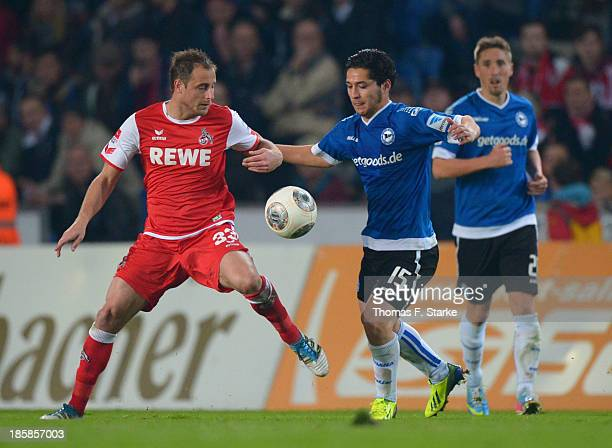 Matthias Lehmann of Koeln and Anass Achahbar of Bielefeld fight for the ball during the Second Bundesliga match between Arminia Bielefeld and 1 FC...