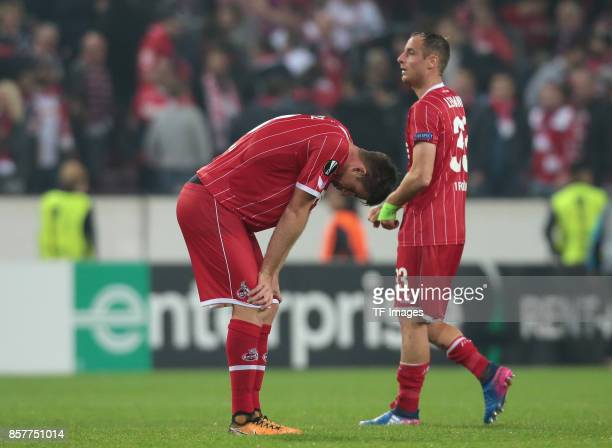 Matthias Lehmann of Koeln and Dominique Heintz looks on during the UEFA Europa League group H match between 1 FC Koeln and Crvena Zvezda at...