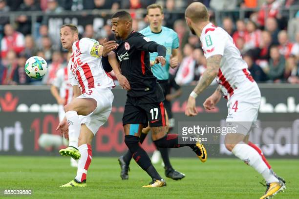 Matthias Lehmann of Koeln and KevinPrince Boateng of Frankfurt battle for the ball during the Bundesliga match between 1 FC Koeln and Eintracht...