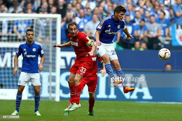 Matthias Lehmann of Koeln and KlaasJan Huntelaar of Schalke go up for a header during the Bundesliga match between FC Schalke 04 and 1 FC Koeln at...