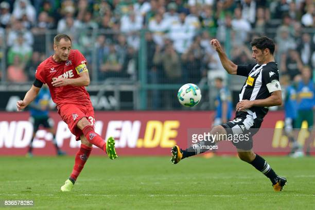 Matthias Lehmann of Koeln and Lars Stindl of Moenchengladbach battle for the ball during the Bundesliga match between Borussia Moenchengladbach and 1...