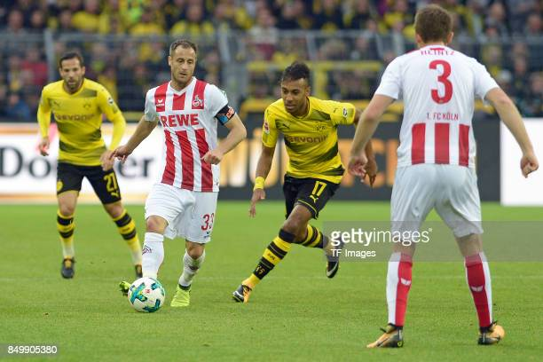 Matthias Lehmann of Koeln and PierreEmerick Aubameyang of Dortmund battle for the ball during the Bundesliga match between Borussia Dortmund and 1 FC...