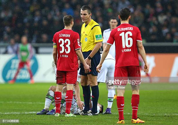 Matthias Lehmann of Koeln argues with referee Knut Kircher during the Bundesliga match between Borussia Moenchengladbach and 1 FC Koeln at...